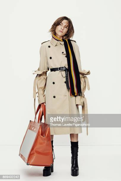 Model Lisa Louis poses at a fashion shoot for Madame Figaro on July 21 2017 in Paris France Bows trench scarf belt tote and boots socks PUBLISHED...