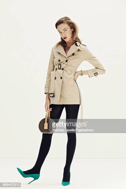Model Lisa Louis poses at a fashion shoot for Madame Figaro on July 21 2017 in Paris France Trench tights necklace bracelet and bag shoes PUBLISHED...