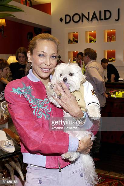 Model Lisa Pliner and her dog Baby Doll attend a preGrammy benefit event on February 12 2005 at the Donald J Pliner boutique in Beverly Hills...