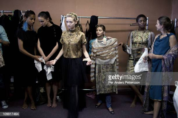 A model listens to the designers forKLuK CGDT during a fitting in preparation for the Joburg Fashion Week on February 14 in Johannesburg South Africa...