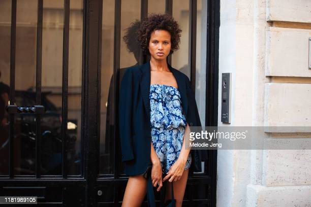 Model Litza Veloz wears a blue blazer and blue paisley dress after the Zuhair Murad show during Couture Fashion Week Fall/Winter 2019 on July 03,...