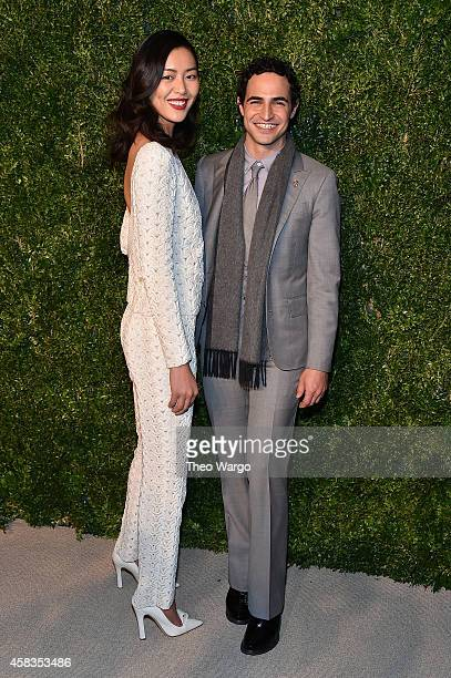 Model Liu Wen and designer Zac Posen attend the 11th annual CFDA/Vogue Fashion Fund Awards at Spring Studios on November 3 2014 in New York City
