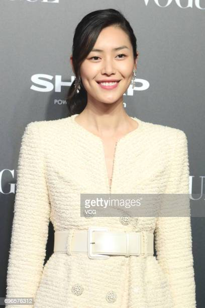 Model Liu Wen arrives at the red carpet of 2017 Vogue Film gala on June 16 2017 in Shanghai China