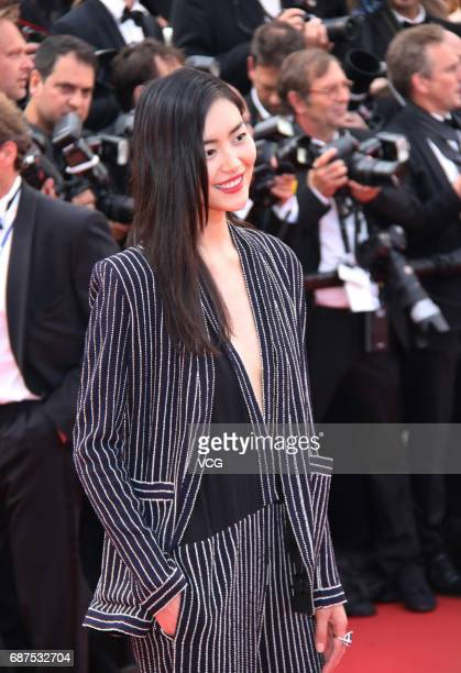 Model Liu Wen arrives on the red carpet of the 70th Anniversary dinner during the 70th annual Cannes Film Festival at Palais des Festivals on May 23...