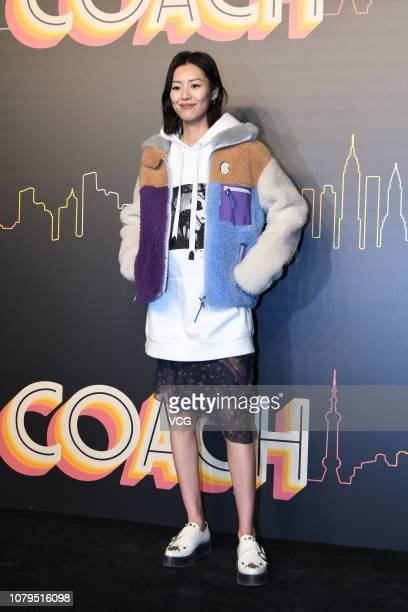 Model Liu Wen poses backstage during the Coach 2019 early autumn collection fashion show 'Coach Lights Up Shanghai' on December 8 2018 in Shanghai...