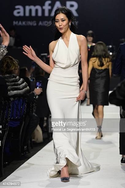 Model Liu Wen walks during the fashion show runway during amfAR's 22nd Cinema Against AIDS Gala Presented By Bold Films And Harry Winston at Hotel du...