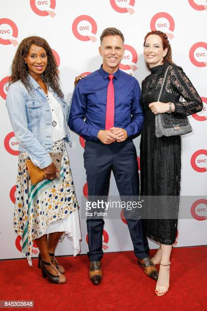 Model Liz Baffoe and the QVC presenters Volker Kirst and Thania Metternich attend a QVC event during the Vogue Fashion's Night Out on September 8...
