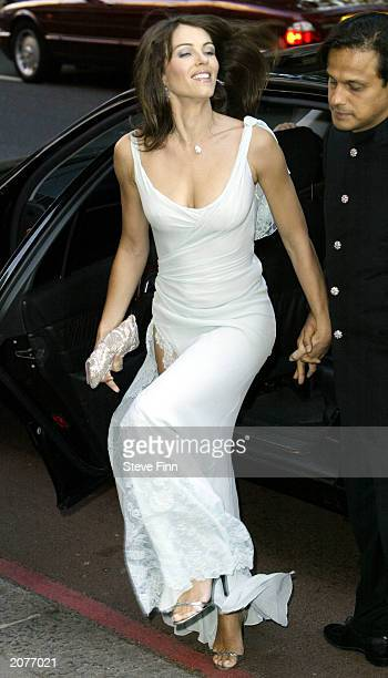 Model Liz Hurley and boyfriend Arun Nayer arrive at the Grosvenor House Art And Antiques Fair at The Grosvenor House Hotel on June 12 2003 in London