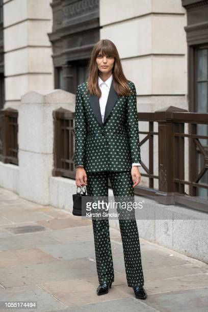 Model Lola McDonnell wears an Alexa Chung suit Simon Miller bag and Saint Laurent shoes during London Fashion Week September 2018 on September 15...