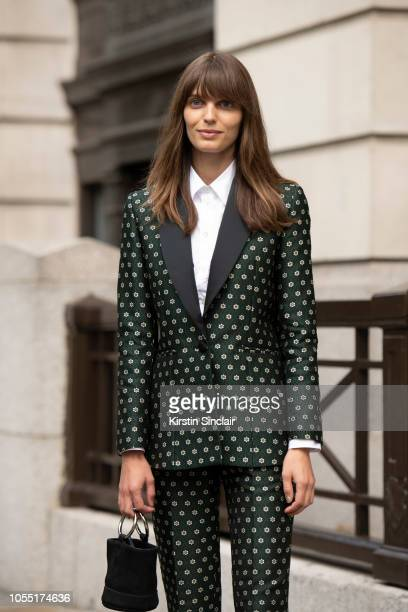 Model Lola McDonnell wears an Alexa Chung suit Simon Miller bag during London Fashion Week September 2018 on September 15 2018 in London England