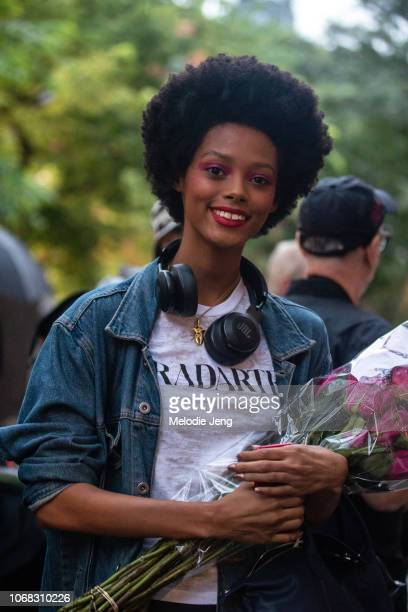 Model Londone Myers wears JBL headphones a Radarte shirt after the Rodarte show during New York Fashion Week Spring/Summer 2019 on September 9 2018...