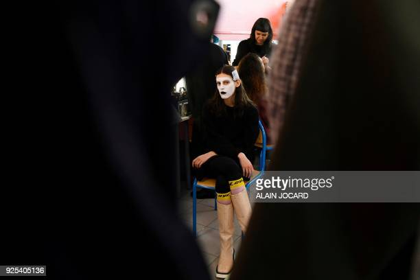 A model looks on in the backstage as she gets ready prior to the Aalto's 2018/2019 fall/winter collection fashion show on February 28 2018 in Paris /...