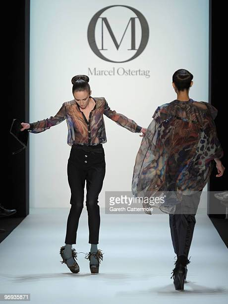 A model looses her shoes on the runway at the Marcel Ostertag Fashion Show during the MercedesBenz Fashion Week Berlin Autumn/Winter 2010 at the...