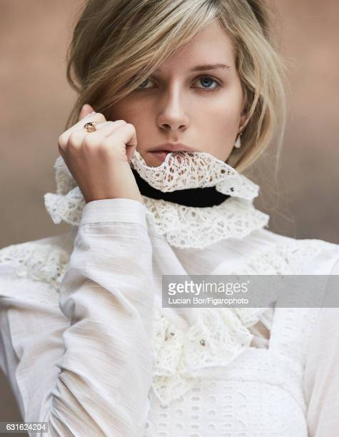 Model Lottie Moss poses at a fashion shoot for Madame Figaro on November 29 2016 in Paris France Blouse overalls Divas Dream earrings and ring...