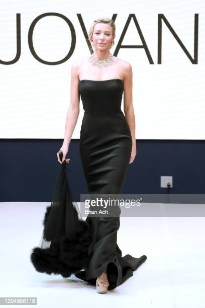 Model Lou Schieffelin walks the runway wearing Bebe's and Liz's presents JOVANI, Special Showcase by Celebrity Jeweler Mike Nekta New York during...