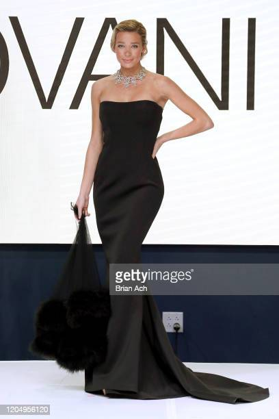 Model Lou Schieffelin walks the runway wearing Bebe's and Liz's presents JOVANI Special Showcase by Celebrity Jeweler Mike Nekta New York during NYFW...