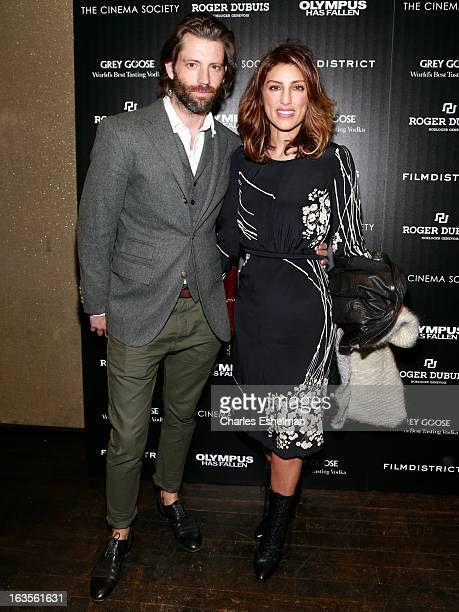 Model Louis Dowler and actress Jennifer Esposito attends The Cinema Society with Roger Dubuis and Grey Goose screening of FilmDistrict's Olympus Has...