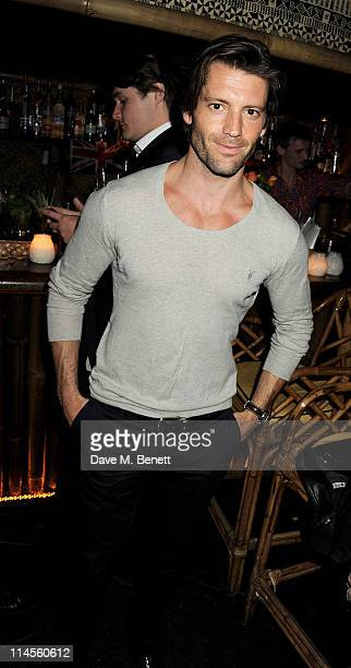 Model Louis Dowler attends the No Tell Motel Southern Comfort Room launch at Mahiki London on May 23 2011 in London England