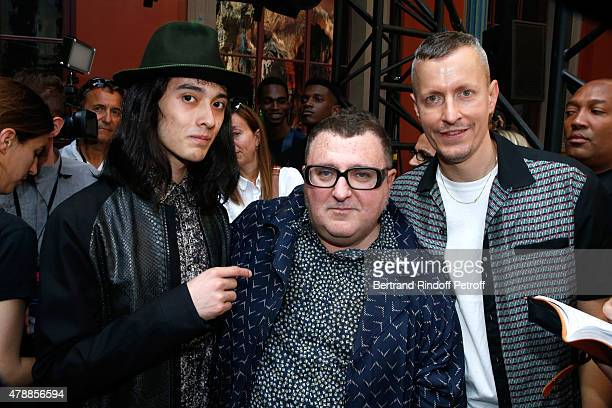 Model Louis Kurihara, Fashion Designer Alber Elbaz and Lanvin men fashion designer Lucas Ossendrijver pose after the Lanvin Menswear Spring/Summer...