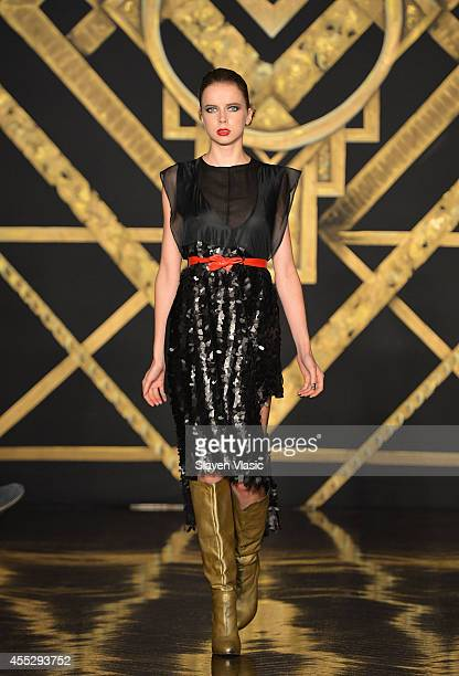 Model Louisa Warwick walks the runway at the Kithe Brewster fashion show during MercedesBenz Fashion Week Spring 2015 on September 11 2014 in New...