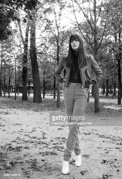 Model Louise Follain poses for a fashion shoot for Madame Figaro on September 21, 2018 in Paris, France. Jacket , poloneck , pants , necklace , boots...