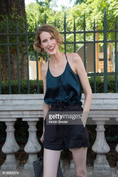 Model Luca Adamik wears a silk camisole top and black shorts day 4 of Paris Haute Couture Fashion Week Autumn/Winter 2017 on July 5 2017 in Paris...