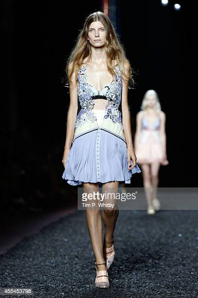 Model Luca Gadjus walks the runway at the Mary Katrantzou show during London Fashion Week Spring Summer 2015 on September 14 2014 in London England
