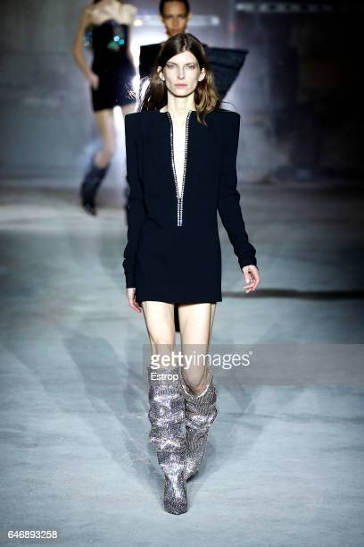 Model Luca Gadjus walks the runway during the Saint Laurent designed by Anthony Vaccarello show as part of the Paris Fashion Week Womenswear...