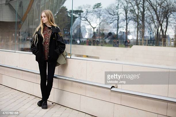 Model Lucan Gillespie exits the Louis Vuitton show at Fondation Louis Vuitton on Day 9 of Paris Fashion Week FW15 on March 11 2015 in Paris France