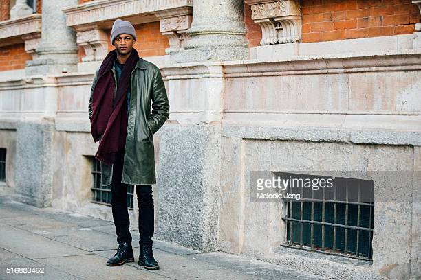 Model Lucas Cristino exits the Missoni show in a vintage green leather coat gray beanie maroon scarf black jeans and black boots during the Milan...