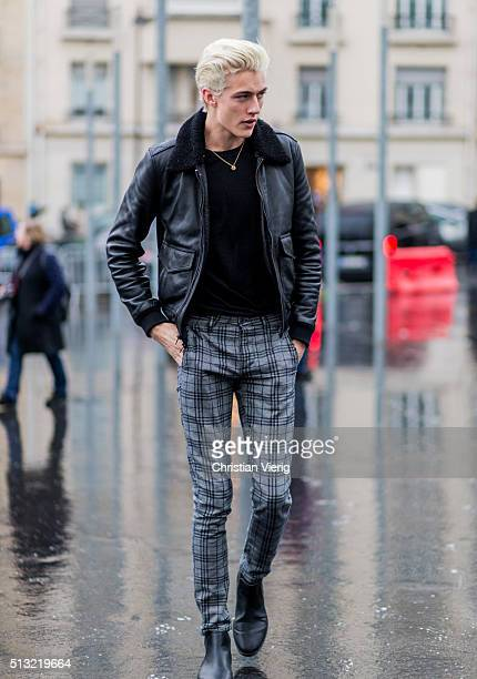 March 1: Model Lucky Blue Smith is seen wearing a black shearling leather jacket and grey plaid pants outside Anthony Vaccarello during the Paris...