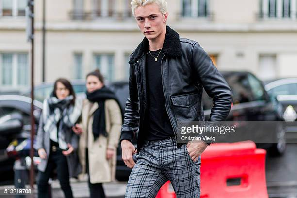 Model Lucky Blue Smith is seen wearing a black shearling leather jacket and grey plaid pants outside Anthony Vaccarello during the Paris Fashion Week...