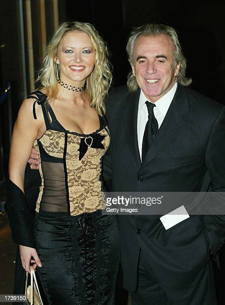 Model Lucy Carr and nightclub owner Peter Stringfellow attend the premier of the new film 'About Schmidt' starring Jack Nicholson at the Warner Bros...