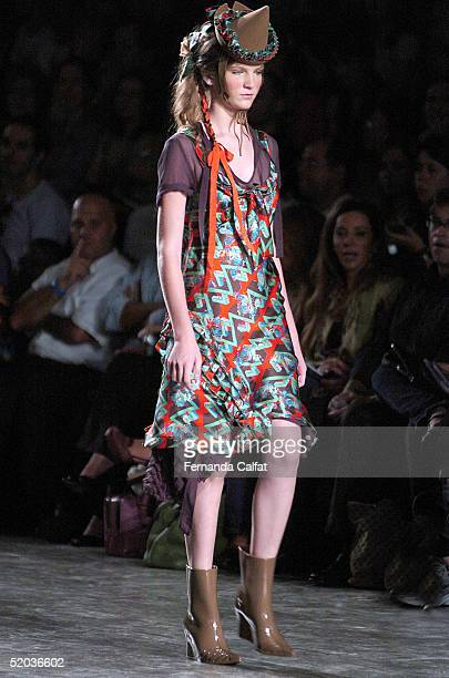 Model Lucy Horn presents a creation by designer Alexandre Herchcovitch during the Fall/Winter 2005 collection of the Sao Paulo Fashion Week at Parque...