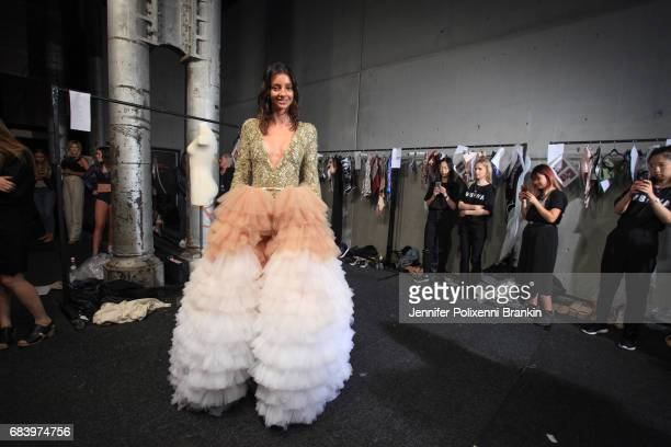 Model Lucy Markovic prepares backstage ahead of the Swim show at MercedesBenz Fashion Week Resort 18 Collections at Carriageworks on May 17 2017 in...