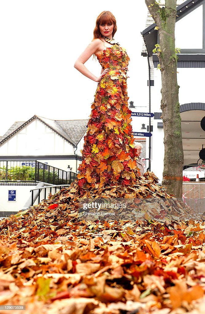 Model Lucy wears 60 metre long dress made of leaves from Delamere Forest in Cheshire to celebrate the final arrival of Autumn/Winter fashion at McArthurGlen Cheshire Oaks Designer Outlet on October 12, 2011 in Ellesmere Port, England.