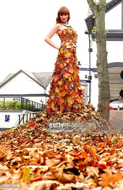 Model Lucy wears 60 metre long dress made of leaves from Delamere Forest in Cheshire to celebrate the final arrival of Autumn/Winter fashion at...