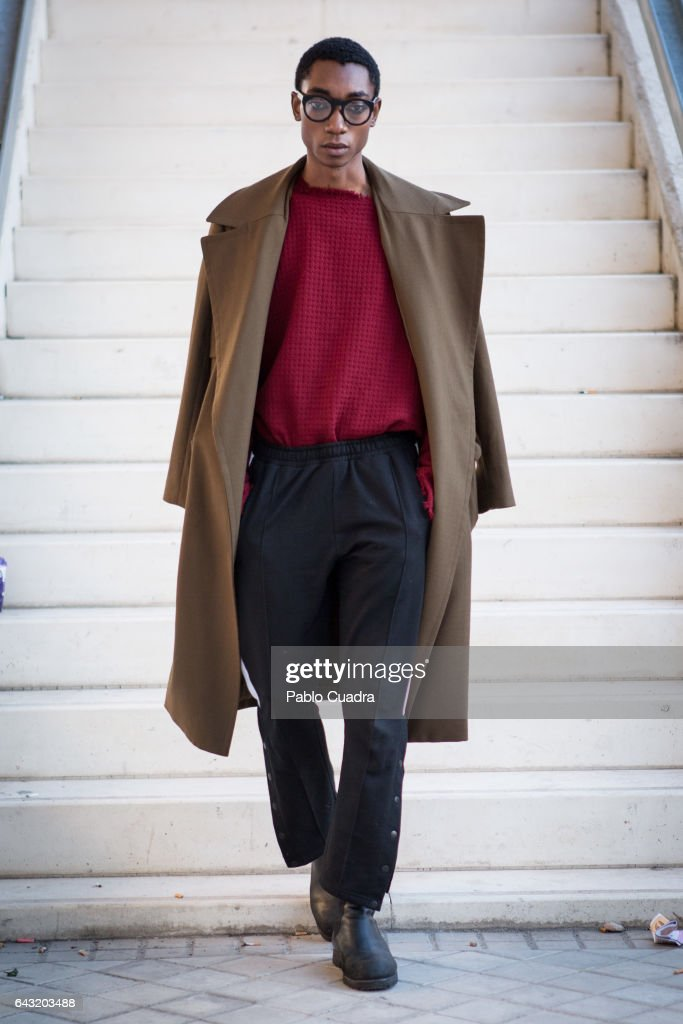 Model Luis Mba wears Bershka trousers , David Poza pullover, H&M coat and Capote Airwear glasses at Ifema during Mercedes Benz Fashion Week Madrid Autumn / Winter 2017 on February 20, 2017 in Madrid, Spain.