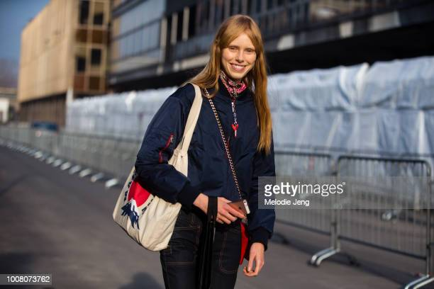 Model Lululeika Ravp Liep wears a blue bomber jacket and tote bag after the Gucci show during Milan Fashion Week Fall/Winter 2017/18 on February 22...