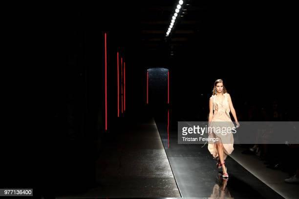 Model Luna Bijl walks the runway at the Dsquared2 show during Milan Men's Fashion Week Spring/Summer 2019 on June 17 2018 in Milan Italy