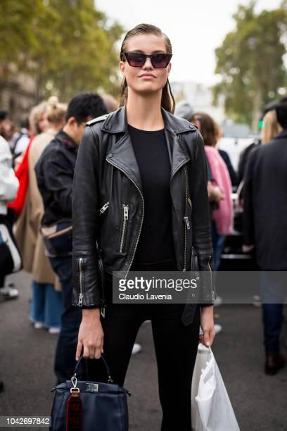 Model Luna Bijl, wearing black top, black pants and black leather jacket, is seen after the Balmain show on September 28, 2018 in Paris, France.