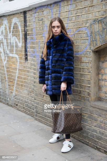 Model Luna Mitchell wears a Louis Vuitton bag Gucci trainers and Nike leggings on day 5 of London Womens Fashion Week Autumn/Winter 2017 on February...