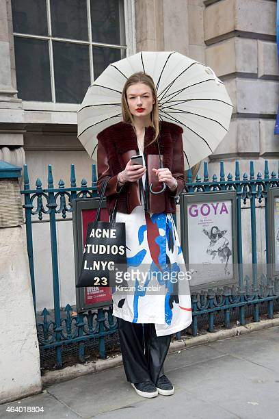 Model Luna Schulze wears an Acne bag Zara trousers Nota Bene shoes and a Freya Dalsjo jacket and kimono on day 1 of London Collections Women on...