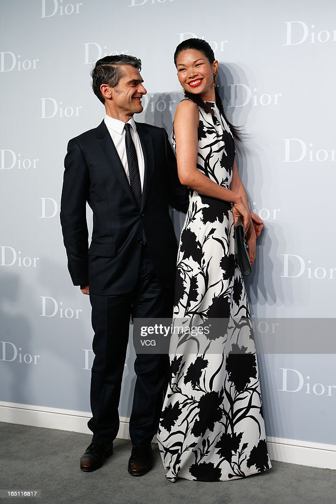 Model Lv Yan (R) attends Christian Dior S/S 2013 Haute Couture Collection at Five on the Bund on March 30, 2013 in Shanghai, China.