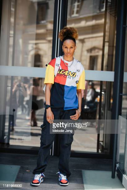 Model Lyne Hafi wears a sports jersey, black cargo pants, and Nike sneakers after the Jean Paul Gaultier show during Couture Fashion Week Fall/Winter...