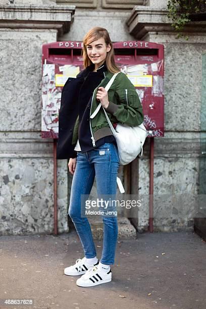 Model Maartje Verhoef exits the Jil Sander show in a Sacai jacket Derek Lam 10 Crosby bag Rag Bone jeans and Adidas sneakers on Day 4 of Milan...