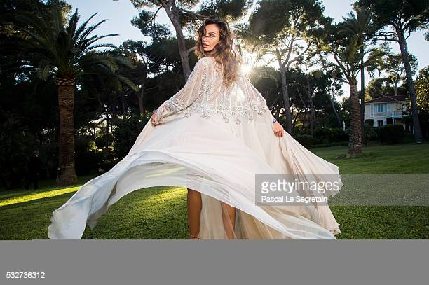 Model Madalina Ghenea poses for photographs at the amfAR's 23rd Cinema Against AIDS Gala at Hotel du CapEdenRoc on May 19 2016 in Cap d'Antibes France