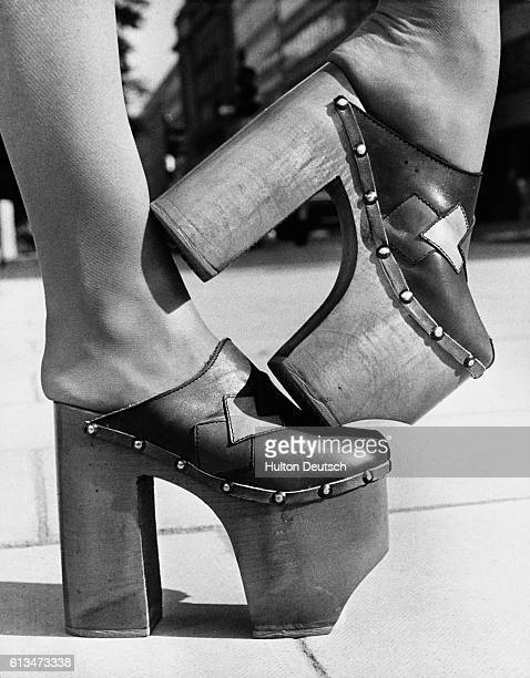 Model Madeleine Bradley shows off a pair of high-rise platform shoes with 8-inch heels at the Spring Shows Exhibition by the British Footwear...