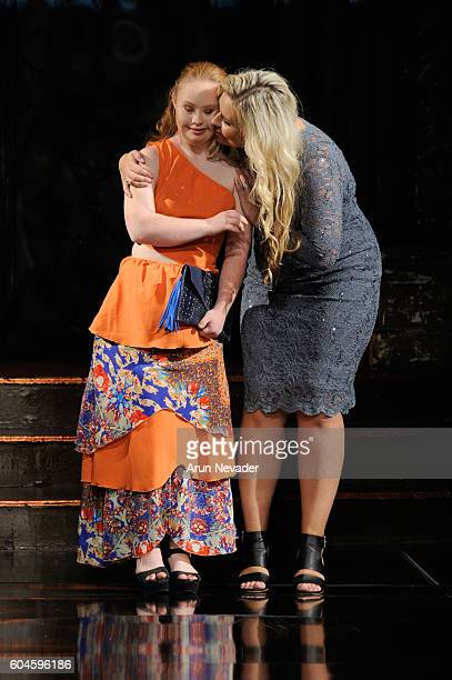 Model Madeline Stuart and designer Carolina Riffi OlliteHopman walk the runway during the House of Byfield show at Art Hearts Fashion NYFW The Shows...