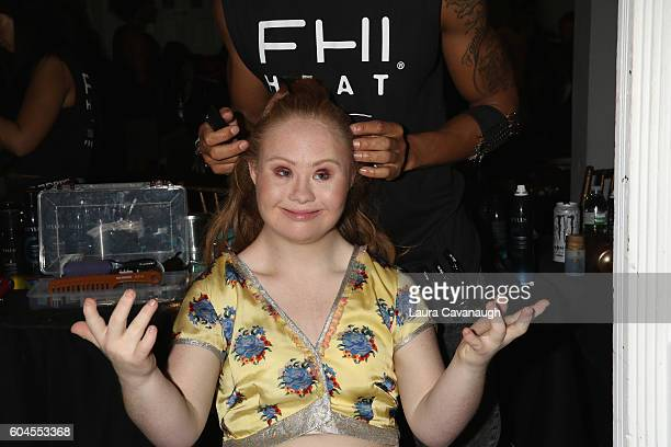 Model Madeline Stuart prepares backstage at Art Hearts Fashion September 2016 during New York Fashion Week The Shows on September 13 2016 in New York...